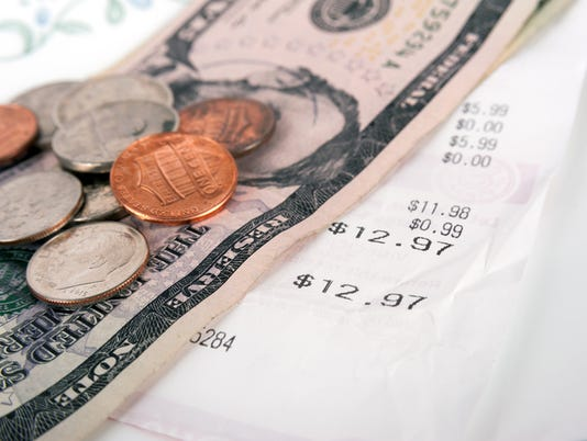 Restaurant bill with dollar bills on a plate and receipt