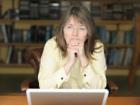 Serious businesswoman with laptop