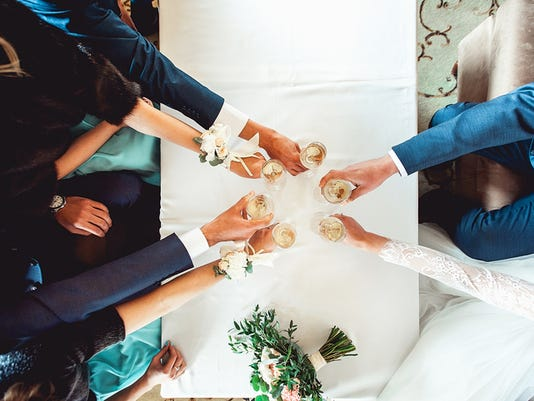 People hold in hands glasses with white wine. wedding party.