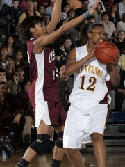 Mount Vernon's Shireyll Moore (12) playing in the Section 1 Class AA girls basketball semifinal at Pace University in Pleasantville Feb. 18, 2005.
