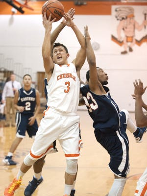Cherokee's Zach Rowe, left, grabs a rebound next to Eastern's Darren Gibson, right, during the second quarter of Thursdays boys basketball game played at Cherokee High School.  02.11.16