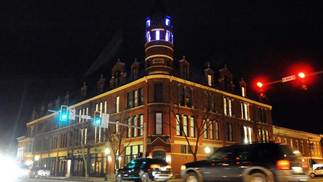 The Carlisle Building at night.