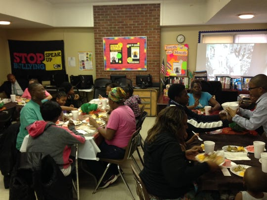 Families whose kids attend the Allenton Heights Boys and Girls Club enjoy a free Thanksgiving dinner on Sunday.