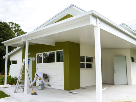 A painter puts on the finishing touches at a home in