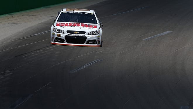 SPARTA, KY - JUNE 27:  Dale Earnhardt Jr., driver of the #88 National Guard Chevrolet, practices for the NASCAR Sprint Cup Series Quaker State 400 presented by Advance Auto Parts at Kentucky Speedway on June 27, 2014 in Sparta, Kentucky.  (Photo by Christian Petersen/Getty Images)
