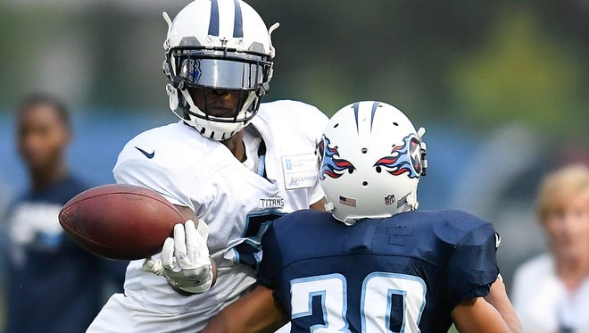 Titans wide receiver Mekale McKay (2) lets a pass slip his grasp as he is defended by cornerback Jeremy Boykins (39) training camp practice at Saint Thomas Sports Park Monday, Aug. 7, 2017 in Nashville , Tenn.