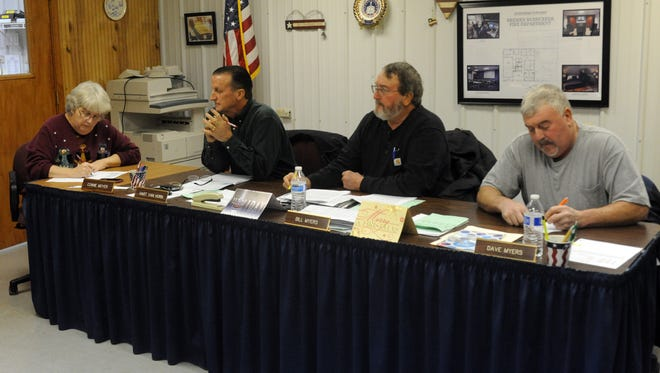 Rushcreek Township Fiscal Officer Connie Moyer, left, takes notes during a township trustee meeting Wednesday, Dec. 21, 2016, in Bremen. Also pictured are trustees Hart Van Horn, second from left, Bill Myers, and Dave Myers, right.