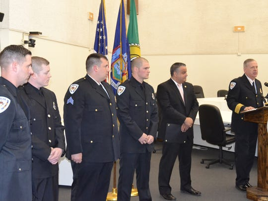 Binghamton Police Sergeant Nicholas Hardy and officers Joshua Bedosky, Seamus Clarke and Robert Ward are recognized Thursday at the department's annual awards ceremony at City Hall for their response to a burglary at a Riverside Drive home in January.