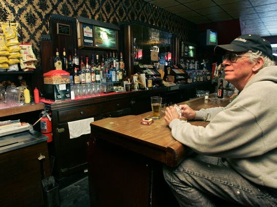 """John Molseed hangs out at George's in Iowa City. The bar was chosen as an Iowa City area """"must-do"""" by Press-Citizen readers. PC photo by Dan Williamson. John Molseed hangs out at George's in Iowa City. The bar was chosen as an Iowa City area """"must-do"""" by Press-Citizen readers."""