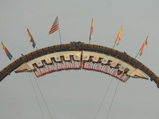 A Ring of Fire ride stops upside down at the 2013 Franklin