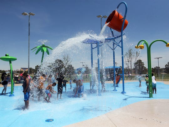 A large bucket of water spilled onto waiting kids in 2017 at the Marty Robbins Spray Park at 11600 Vista Del Sol Drive as the temperature reached the triple-digit mark.