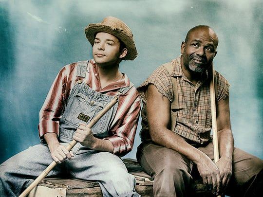"""Teal Davis as Huck Finn and Elliott Robinson as Jim in """"Big River."""""""