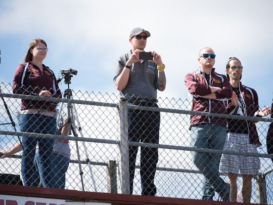 Concord High School band director Domenic Pisano (center) films his band's performance from atop the press box at the Sept. 9 football game against Salesianum.
