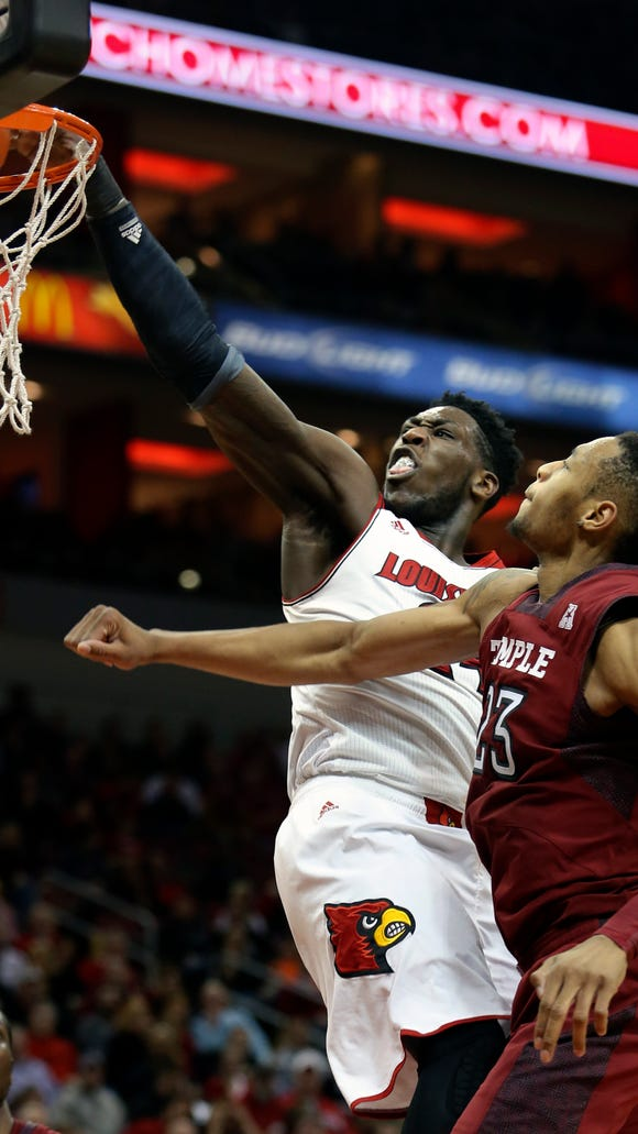 Louisville's Montrezl Harrell slams home a dunk with autority against Temple's Devontae Watson in February.