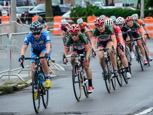 Professional female cyclists go down Hawley Street during the 31st Chris Thater Memorial Races on Saturday.