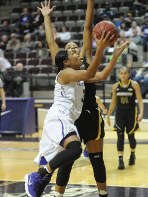 ACU's Dominique Golightly drives to the basket against a Southeastern Louisiana defender in the fourth quarter. ACU beat the Lady Lions 86-80 in the Southland Conference game Saturday, Jan. 6, 2018 at Moody Coliseum.