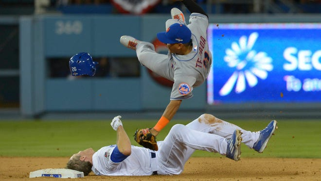 Ruben Tejada collides with Chase Utley at second base in the 7th inning.