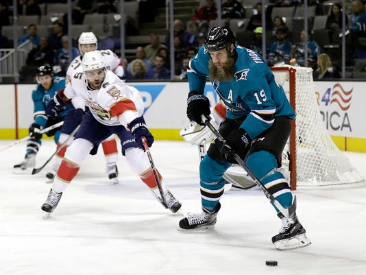 San Jose Sharks' Joe Thornton (19) controls the puck in front of Florida Panthers' Aaron Ekblad (5) during the first period of an NHL hockey game Thursday, Nov. 16, 2017, in San Jose, Calif. (AP Photo/Marcio Jose Sanchez)