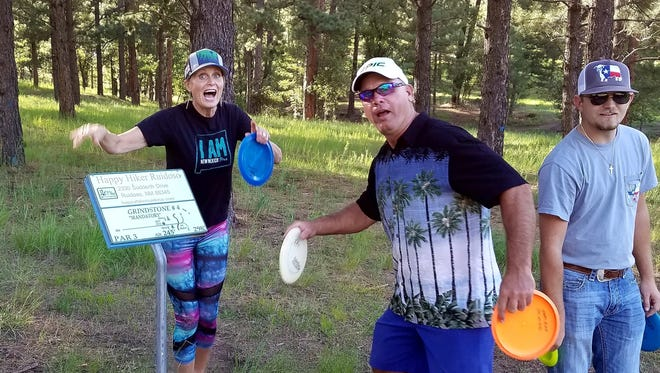 Anna, Billy and Rhett at hole No. 4 during their golf disc outing in Ruidoso.