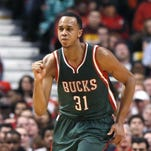 Milwaukee Bucks center John Henson (31) celebrates his basket late in the second half in Game 5 of the NBA basketball playoffs against the Chicago Bulls April 27 in Chicago. The Bucks won 94-88.