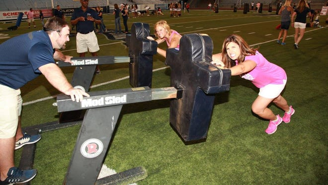 Participants take part in the 2016 version of the Wolf Pack's women's football clinic.