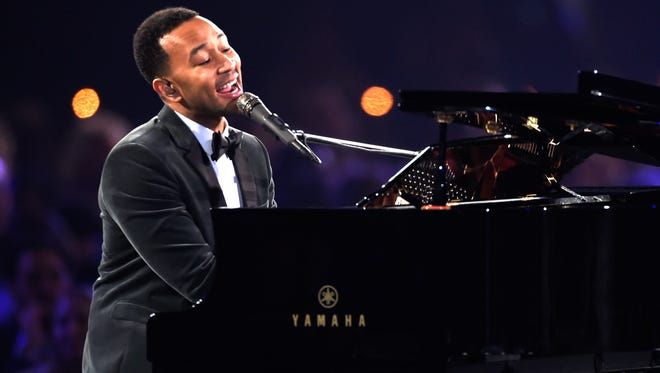 """John Legend will hold a concert Sunday in Cincinnati. Here, he performs """"at the MusiCares Person of the Year tribute honoring Lionel Richie in February. (Photo by Chris Pizzello/Invision/AP)"""
