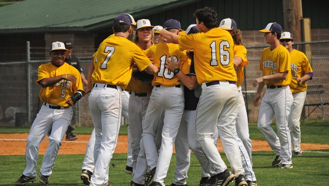 Benton's Jackson Rutledge is congratulated after a 2014 save.