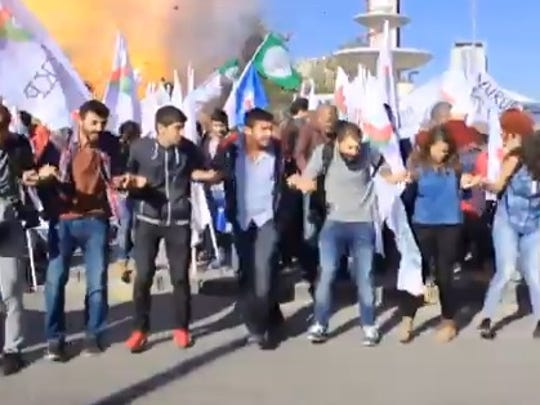 TV video shot by the Dogan News agency and broadcast on Suzco TV shows the moment of the blasts ahead of a peace rally in Ankara, Turkey, Oct. 10, 2015.