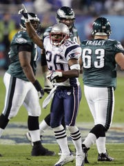 New England Patriots free safety Eugene Wilson (26) celebrates a second quarter fumble recovery from Philadelphia Eagles center Hank Fraley (63) during Super Bowl XXXIX at Alltel Stadium in Jacksonville, Fla., on Sunday, Feb. 6, 2005. (AP Photo/Amy Sancetta)