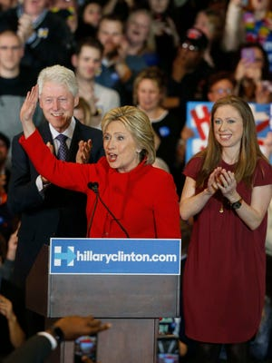 Democratic presidential candidate Hillary Clinton celebrates with her husband, former president Bill Clinton, and their daughter, Chelsea, on caucus night at the Olmsted Center at Drake University in Des Moines, on Monday, Feb. 1, 2016.