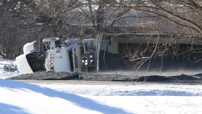 Highway 21 was closed for a few hours between Oakwood Road and Sand Pit Road as crews removed an overturned truck that spilled its contents onto the roadway.