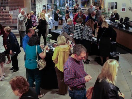 """More than 150 people enjoyed a strolling dinner, with specialties from 10 area restaurants, and live jazz during """"Booked for the Evening"""" at the Novi Public Library on Oct. 13."""