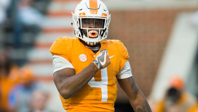 Tennessee running back John Kelly (4) celebrates a touchdown during a game between Tennessee and Vanderbilt at Neyland Stadium in Knoxville, Tenn., on Saturday Nov. 25, 2017.