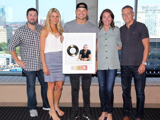 "At Kane Brown's surprise ""What Ifs"" gold certification"