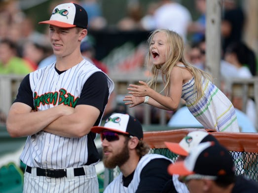 Appleton resident Aubrey Disch, 5, cheers on the Green Bay Bullfrogs in their final game of the season against the Wisconsin Rapids Rafters at Joannes Stadium in Green Bay Wis. on Sunday, Aug. 10, 2014. Disch's brother Nathan is a pitcher for the team and said his sister comes out to support him at every home game. Kyle Bursaw / Press-Gazette Media