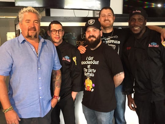 "Guy Fieri, host of ""Diners, Drive-ins and Dives,"" poses with The Dirty Buffalo staff. Shown left to right is Fieri; Chris McLeod, kitchen manager; Ryan Lynn, general manager; Russell Gilbert, co-owner; and Sharif McCoy. kitchen manager."