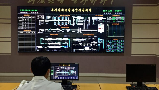 In this Dec. 20, 2017, photo, an employee monitors production from the control room of the Ryugyong Kimchi Factory in Pyongyang, North Korea.