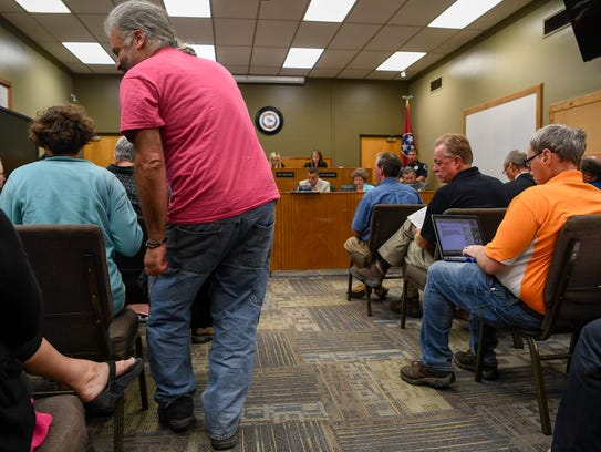 Members of the Shelbyville community file into the