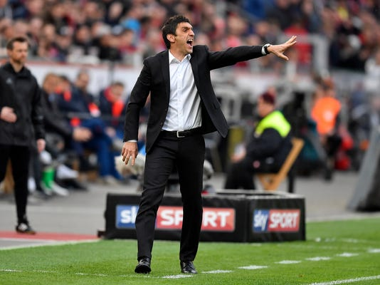FILE - In this April 15, 2017 file photo then Leverkusen's head coach Tayfun Korkut gestures during the German Bundesliga soccer match between Bayer Leverkusen and Bayern Munich in Leverkusen, Germany. Stuttgart has hired Tayfun Korkut as coach to replace Hannes Wolf, the coach who led the side to Bundesliga promotion last season. The club says the 43-year-old Korkut, a Stuttgart native, is getting a contract to summer 2019.  (AP Photo/Martin Meissner, file)