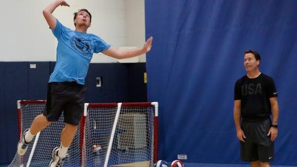 Suffern High School's Scott Walsh serves the ball as