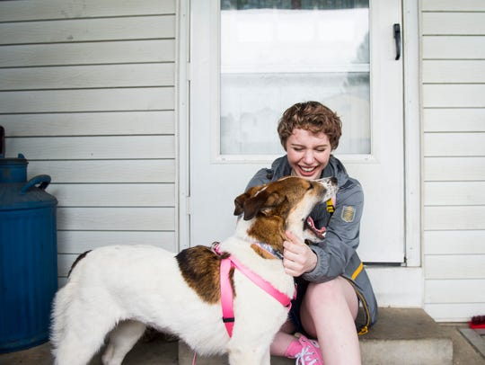 Skye Young, 16, plays with her new rescue dog, Olive,