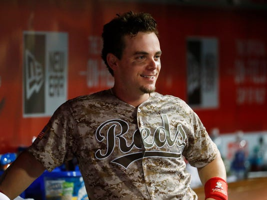 Cincinnati Reds' Scooter Gennett smiles in the dugout during the seventh inning of a baseball game against the St. Louis Cardinals, Tuesday, June 6, 2017, in Cincinnati. The Reds won 13-1. (AP Photo/John Minchillo)