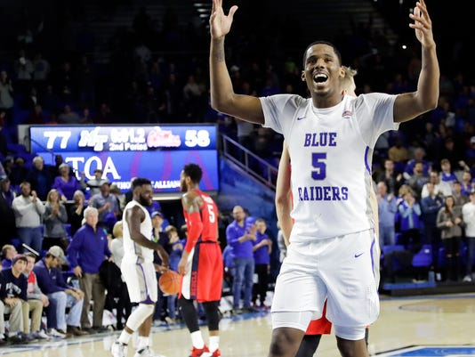 Middle Tennessee forward Nick King (5) celebrates in the final seconds of the team's 77-58 win over Mississippi in an NCAA college basketball game Saturday, Dec. 9, 2017, in Murfreesboro, Tenn. (AP Photo/Mark Humphrey)