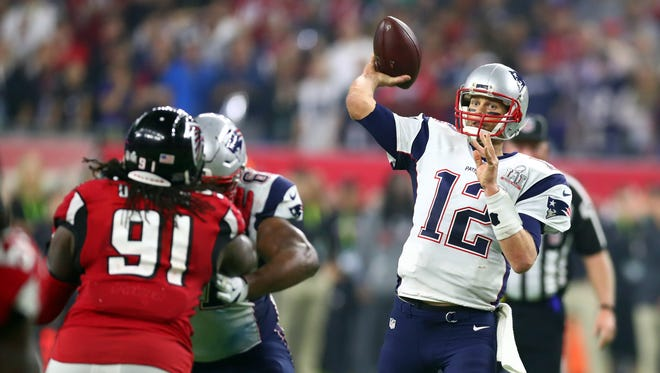 New England Patriots quarterback Tom Brady (12) throws a pass against the Atlanta Falcons in overtime during Super Bowl LI at NRG Stadium.