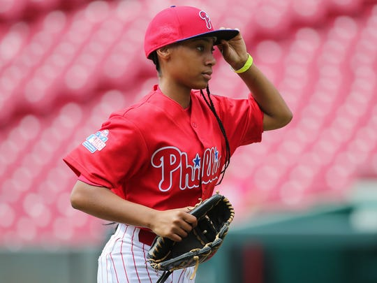 Phillies RBI pitcher Mo'ne Davis runs off the mound in the fourth inning during regional play in the 2017 RBI World Series, Aug. 1, 2017, at Great American Ball Park in Cincinnati.