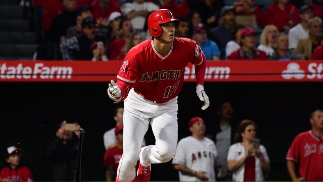 Apr 27, 2018; Anaheim, CA, USA; Los Angeles Angels starting pitcher Shohei Ohtani (17) reacts to his solo home run off of New York Yankees starting pitcher Luis Severino (40) (not pictured) in the second inning of the game at Angel Stadium of Anaheim.