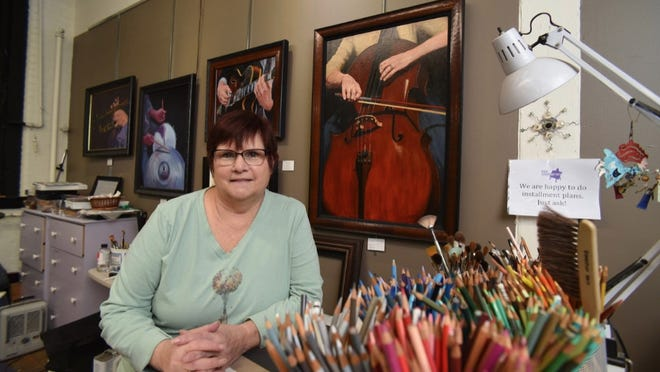 Pittsford painter Suzi Zefting-Kuhn in her studio at the Hungerford Building in Rochester.