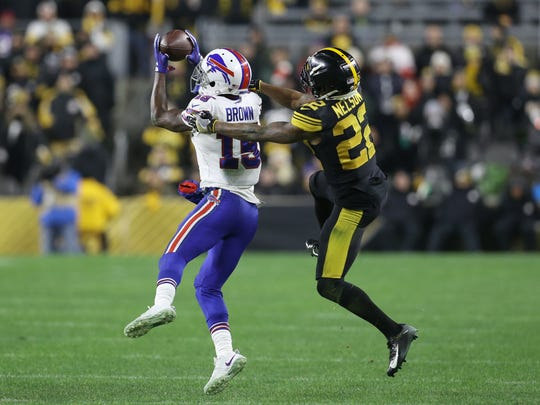 Buffalo Bills wide receiver John Brown (15) makes a catch in front of Pittsburgh Steelers cornerback Steven Nelson (22) during the fourth quarter at Heinz Field. Buffalo won 17-10.