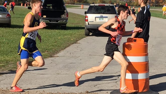 Brighton's Zach Stewart (right) finished 28th in the state Division 1 cross country meet to make All-State as a freshman.