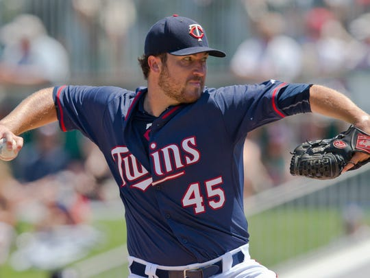 Minnesota Twins starting pitcher Phil Hughes delivers against the Boston Red Sox in the first inning during an exhibition spring training baseball game, Wednesday, April 1, 2015, in Fort Myers, Fla. (AP Photo/Brynn Anderson)